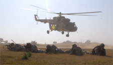 An Indian Army Mi-17 hovers in the background after dropping of US Army troops in the joint 'Yudh Abhyas' exercise with the Indian Army held in 2009