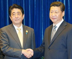 Japanese Prime Minister Shinzo Abe and China's President Xi Jinping