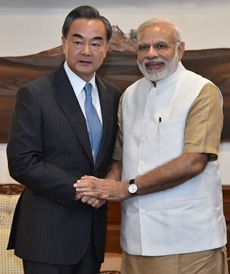 China's foreign Wang Yi with Prime Minister Narendra Modi in New Delhi on 13 August 13