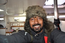 This picture was taken sometime in the third month of the voyage in the Southern Ocean (Antarctic), where the eemperature was about 4 degrees. I was wearing a Russian ushanka hat that I had bought in a flee market in Goa in 2011.